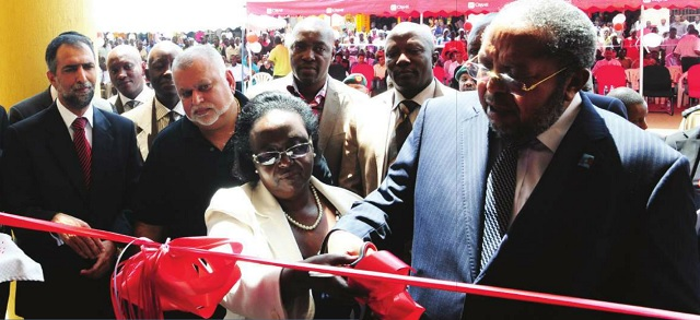 Good times: Bank of Uganda governor Tumusiime Mutebile launches a Crane Bank branch as Sudhir Ruparelia (2L) looks on. The relationship between the regulator and the bank have fallen on hard times in recent month Independent/Jimmy Siya