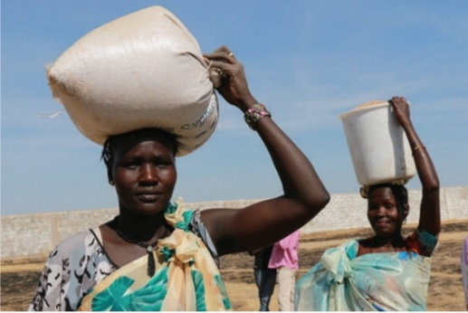 Karimojong women carrying food items