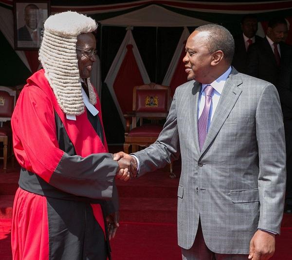 Maraga (left) congratulated by Uhuru Kenyatta
