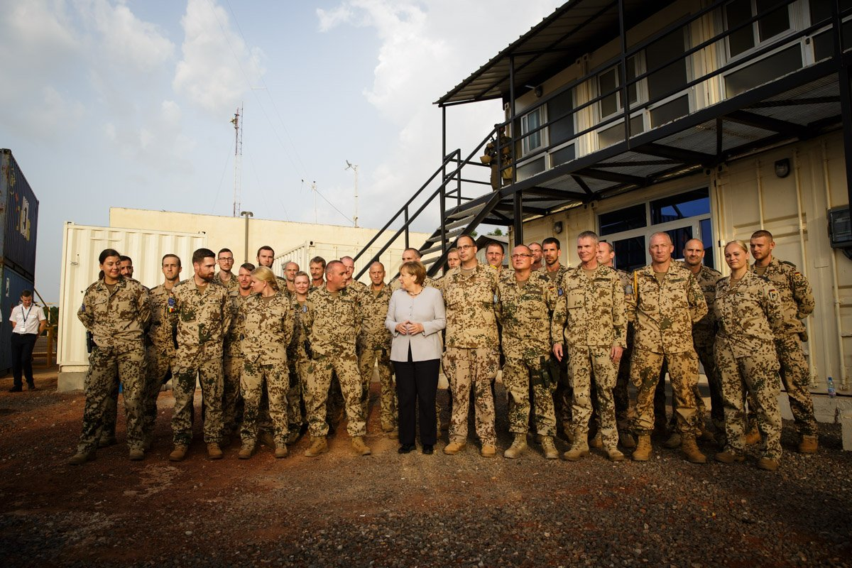 Merkel visits troops  in Mali. A blast has killed a French soldier