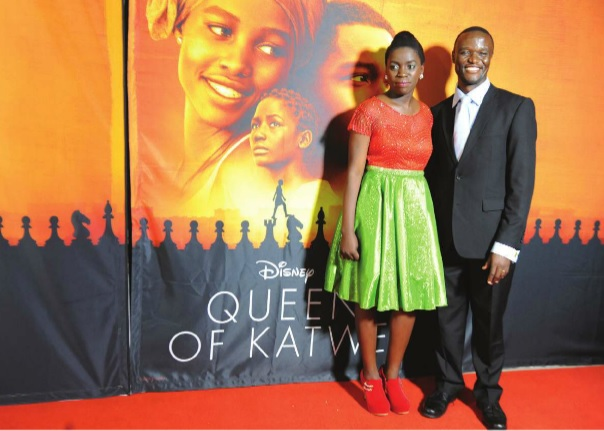 Phiona Mutesi, on whom the film 'Queen of Katwe' is based and Robert Katende, the man who taught her chess, at the premiere in Kampala. Independent/Jimmy siya