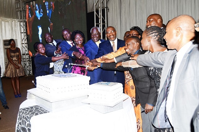 Prime Minister Rugunda, URA board chairman Dr. Simon Kagugube and CG Doris Akol join guests in cutting the 25-year celebrations cake.