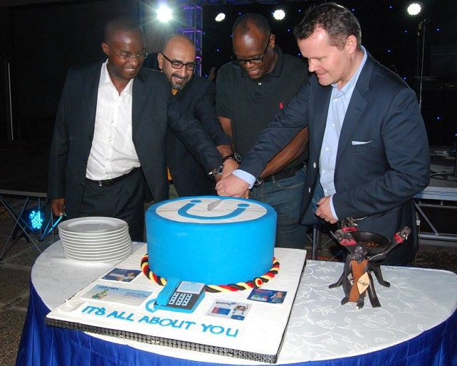 Uganda Telecom MD Shoebridge and other officials cut a cake as the company recognised its top customers in the Customer Appreicaition Week at Sheraton in September.