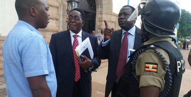 Makerere Vice Chancellor Dr Ddumba talks to officials moments before the university was closed.