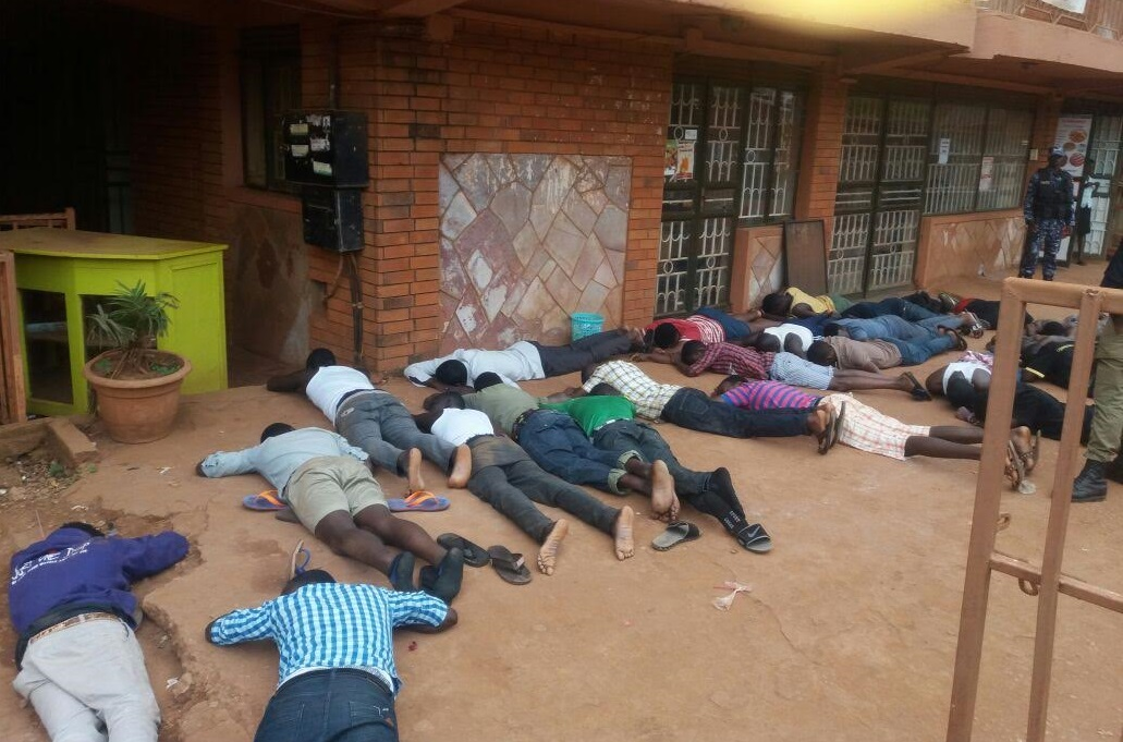 The striking Students from Douglas Villa Hostel ordered to lie down low like envelopes by the Military Police. PHOTO GODFREY SSALI