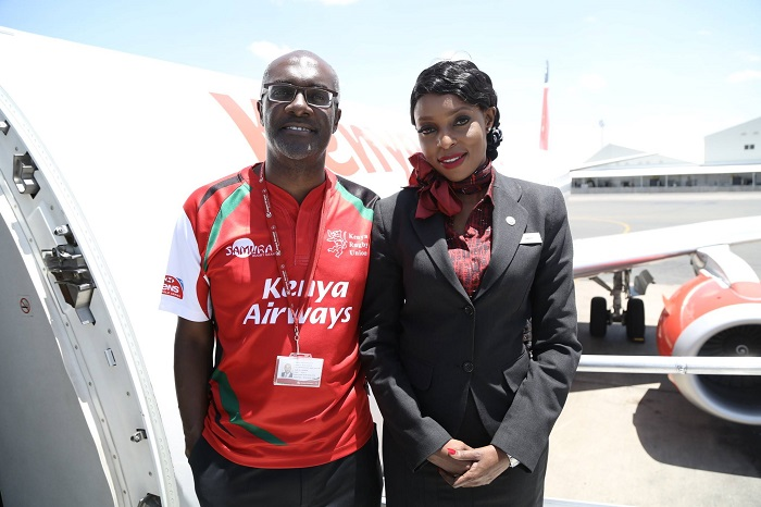CEO Mbuvi (left) with a crew member of Kenya Airways during customer week recently.