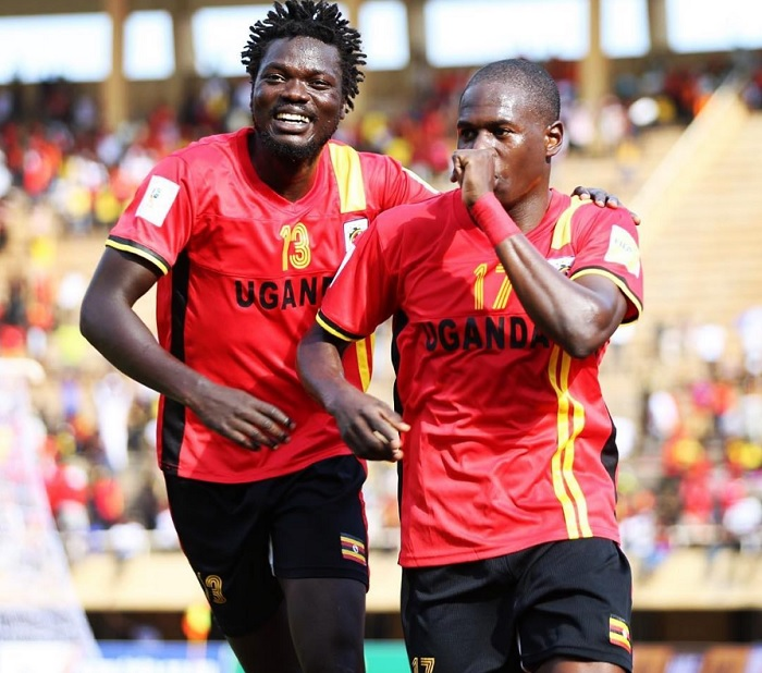 CELEBRATIONS: Oloya (left) joins goal scorer Miya. PHOTO KCCAUG