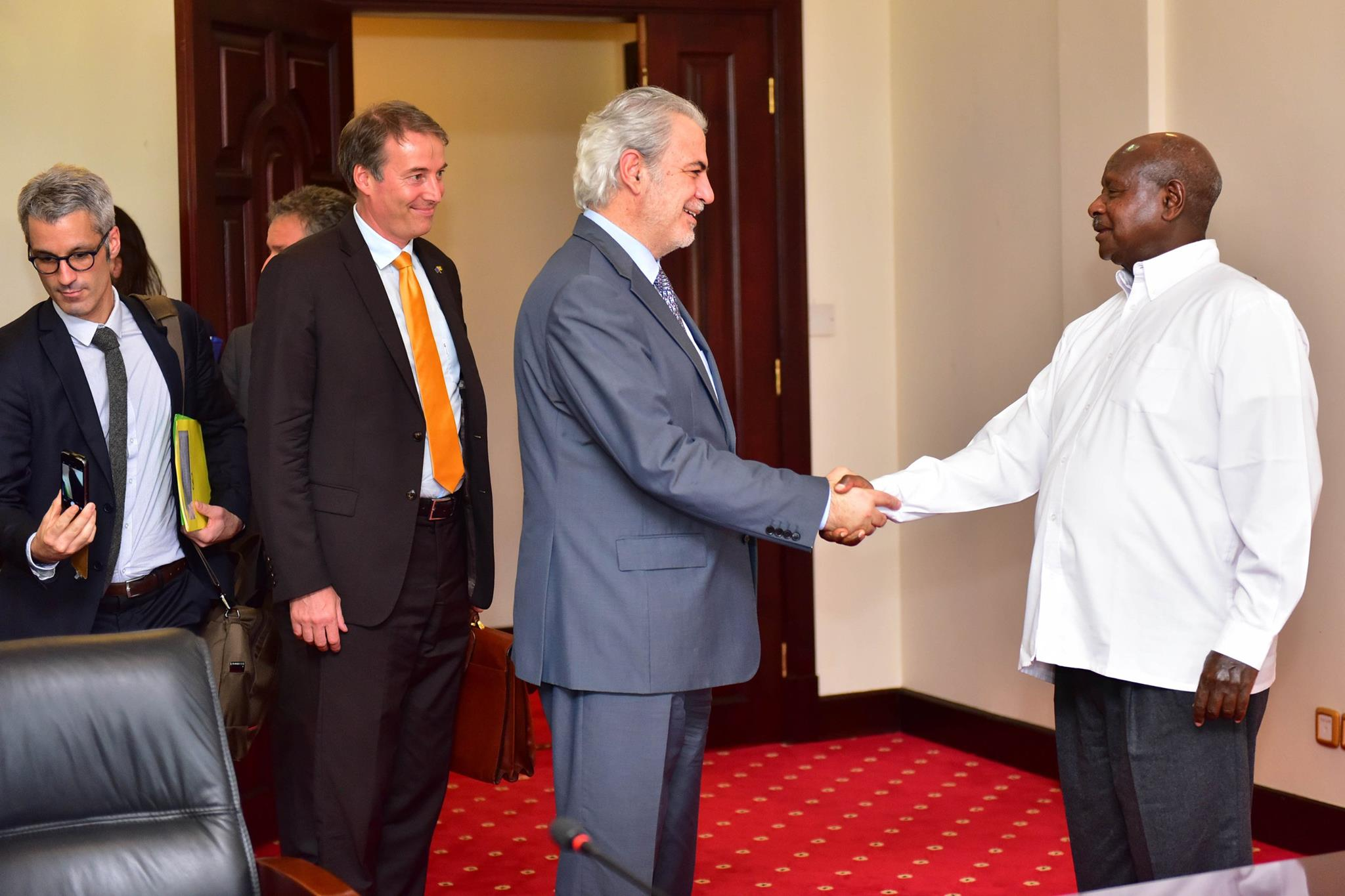 Commissioner for Humanitarian Aid and Crisis Management Christos Stylianides shakes hands with Ugandan President Yoweri Museveni during his visit to Uganda.