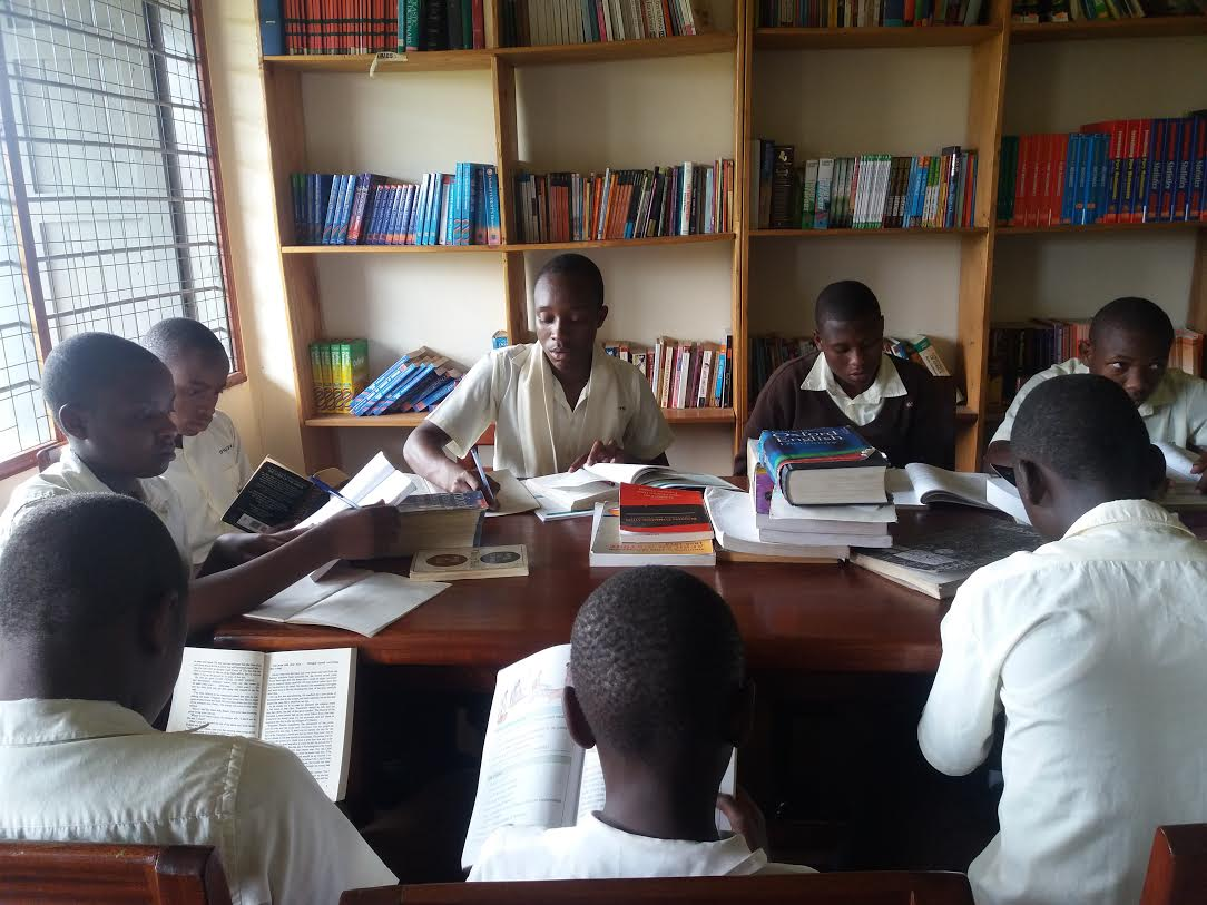 Some of the students in the community library constructed by Nyaka