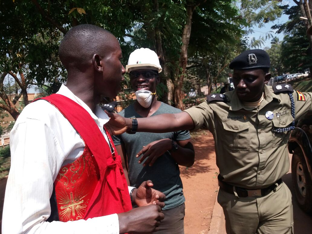 The chief security officer of Makerere university Jackson Mucunguzi argues with a striking student. PHOTO BY GODFREY SSALI