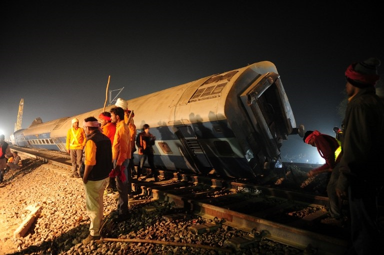 Rescue workers operate at the site of a derailed train near Pukhrayan in Kanpur district on November 20, 2016. Emergency workers raced to find any more survivors in the mangled wreckage of an Indian train that derailed on November 20, killing at least 120 people, in the worst disaster to hit the country's ageing rail network in recent years. PHOTO AFP