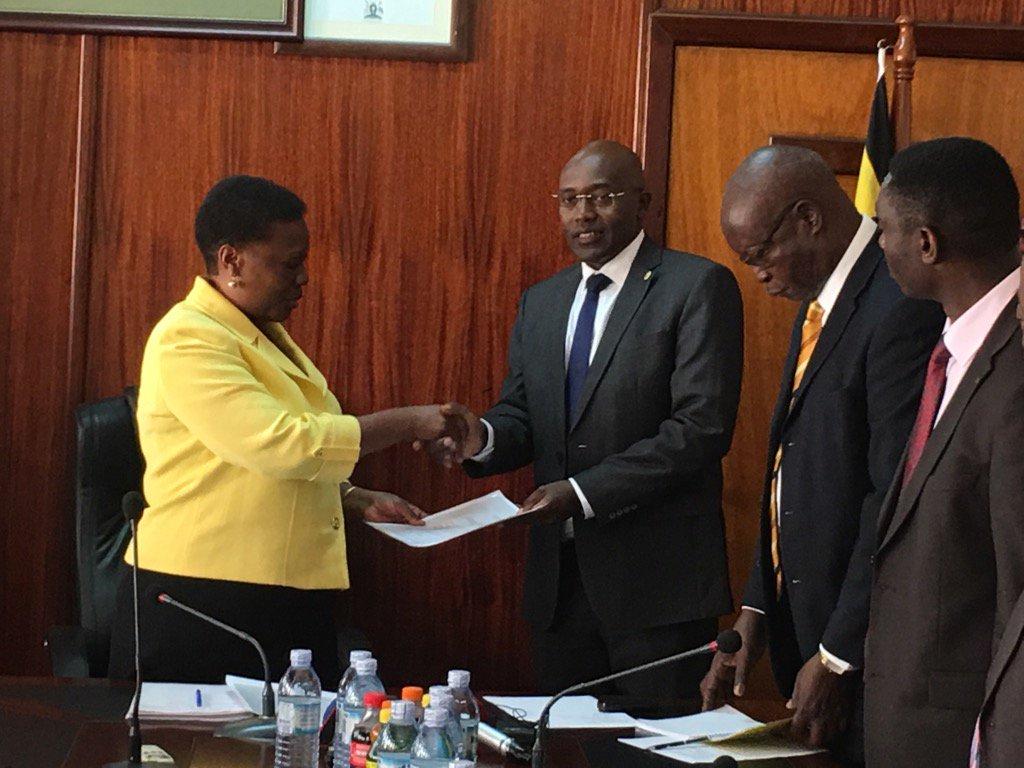 Muloni hands documents to UEGCL CEO Mutikanga