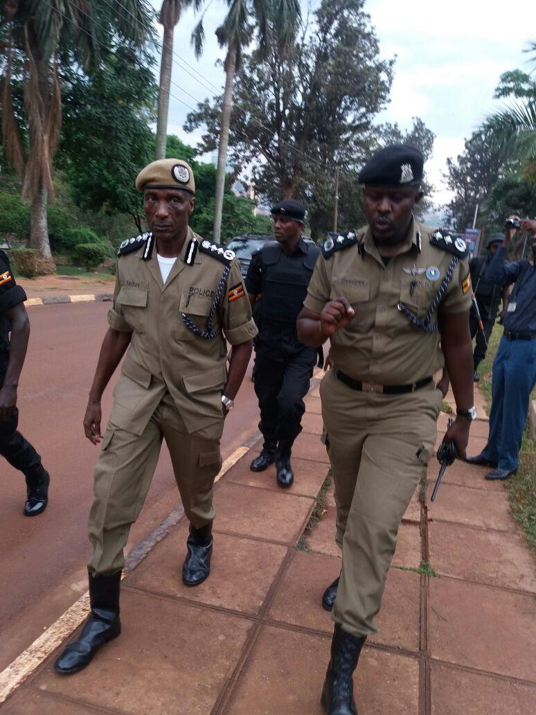 The Inspector General of Police Gen.Edward Kale Kayihura flanked by Kampala Metropolitan Police Commander arrive at Makerere university