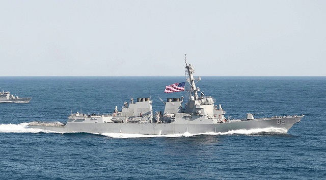 US warship sails near island; China protests